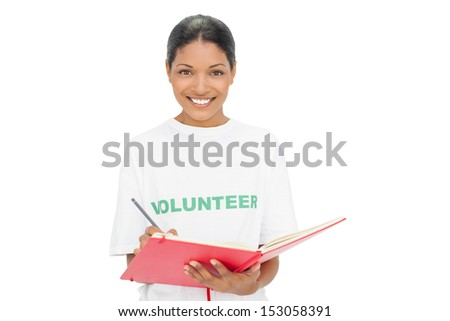 Happy model wearing volunteer tshirt on white background writing