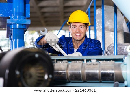 happy modern blue collar worker in factory - stock photo