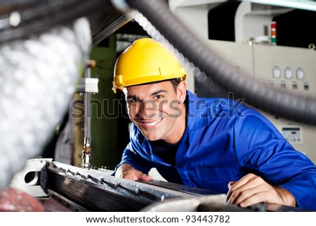 happy modern blue collar worker in factory