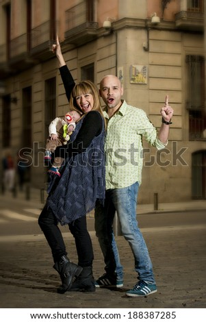 happy modern couple with newborn baby boy celebrating life not ending with parenthood but beginning - stock photo