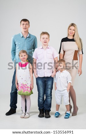 Happy modern family of five people in the studio - stock photo