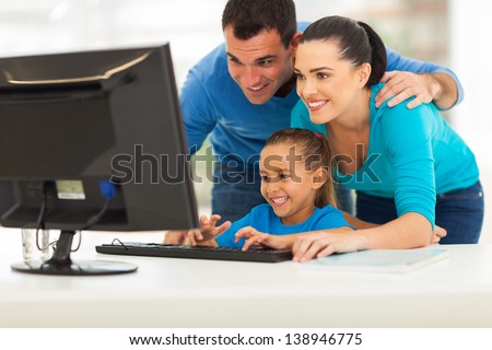 happy modern family using computer together at home - stock photo