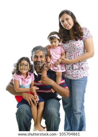 Happy modern Indian family portrait on white background