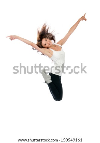 Happy modern slim style teenage girl jumping dancing isolated on a white studio background - stock photo