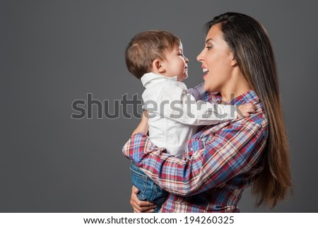 Happy mom and cute little boy - stock photo