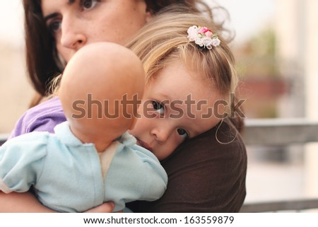 happy mom and daughter outdoors - stock photo