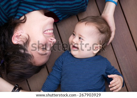happy mom and daughter playing - stock photo