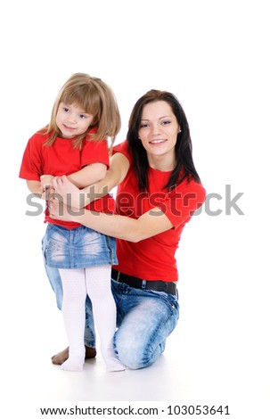 happy mom and her daughter posing on white