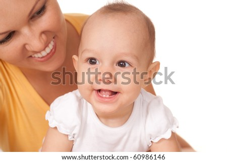 happy mom holds the baby