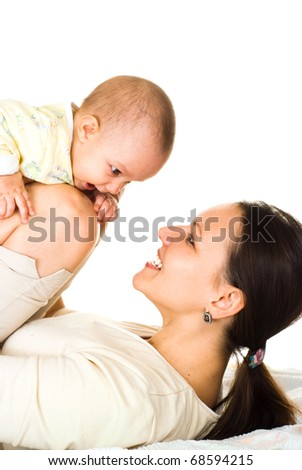 happy mom holds the baby on a light background
