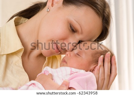 happy mom holds the baby on a white - stock photo