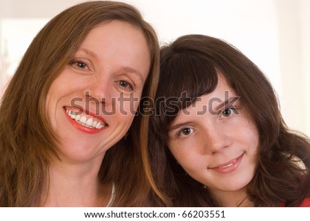 happy mom is with her daughter on a white background - stock photo