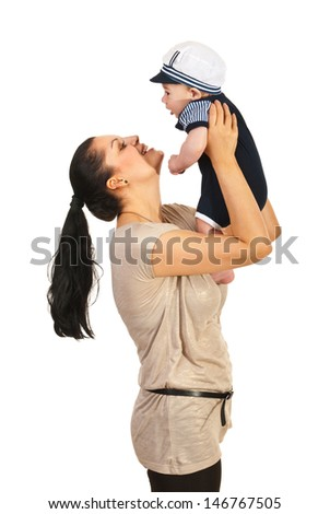 Happy mom playing with her baby boy and raising up isolated on white background - stock photo