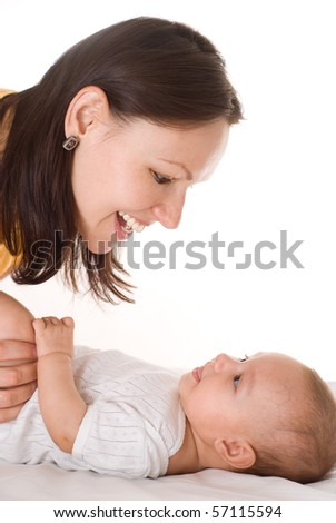 happy mom stands and holds the baby - stock photo
