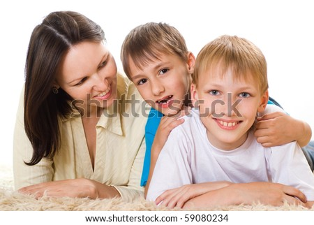happy mom with  children on a white