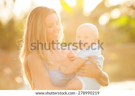 Happy mom with her baby boy - stock photo