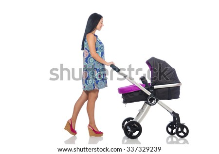 Happy mom with her baby in pram  - stock photo
