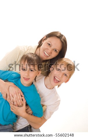 happy mom with two children on a white background