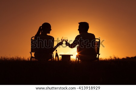 Happy moments. Young couple enjoying a glass of wine in the park.  (Happiness and love concept)  - stock photo