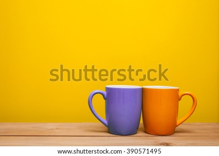 Happy Monday Coffee Cup Concept isolated on yellow background - stock photo