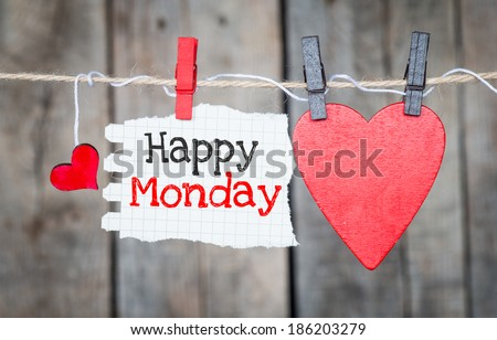 Happy Monday on instant paper and small red hearts hanging on the clothesline. On old wood background - stock photo