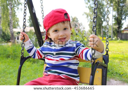Happy 22 months baby boy on swing