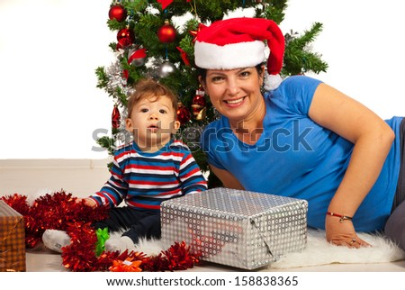 Happy Mother and baby boy celebrate  first Christmas together isolated on white background - stock photo