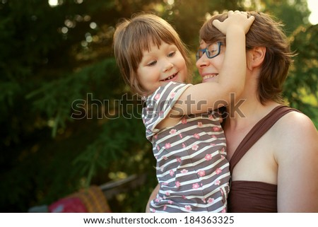 Happy mother and baby having fun