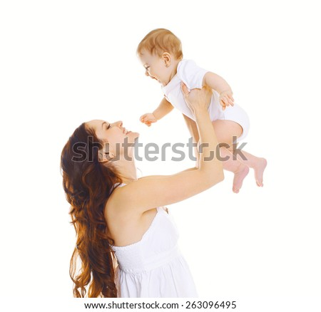 Happy mother and baby having fun together - stock photo