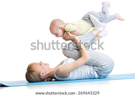 happy mother and baby son making healthy fitness exercises - stock photo