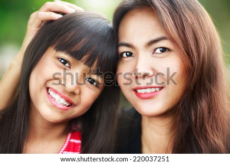 Happy mother and child girl, Outdoor - stock photo