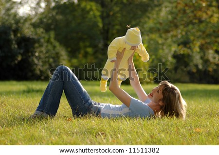 happy mother and child in park