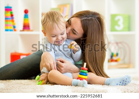 happy mother and child son play  indoor at home - stock photo
