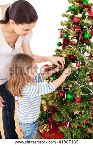 Happy mother and daughter at home at Christmas time - stock photo