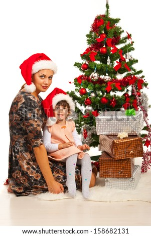 Happy mother and daughter celebrate Christmas together - stock photo