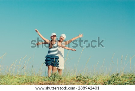 Happy mother and daughter enjoying nature