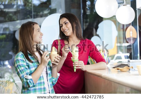 Happy Mother And Daughter Having Ice Creams - stock photo
