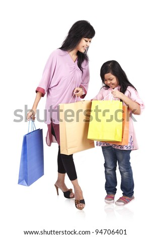 Happy mother and daughter holding shopping bags isolated on white - stock photo