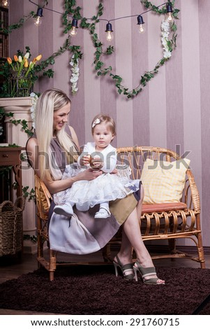 Happy mother and daughter in living-room - stock photo