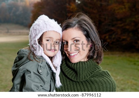 Happy mother and daughter in nature - stock photo