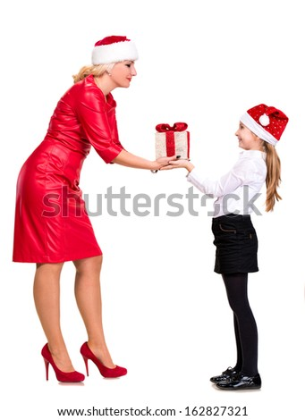 Happy mother and daughter in santa hats with gift box on a white background