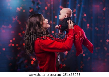 Happy mother and daughter in the background Christmas tree - stock photo