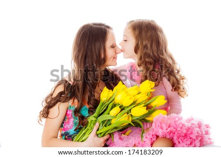 happy mother and daughter in the studio with a bouquet of yellow tulips. spring isolation. March 8, International Women's day, valentine's day, mother's day