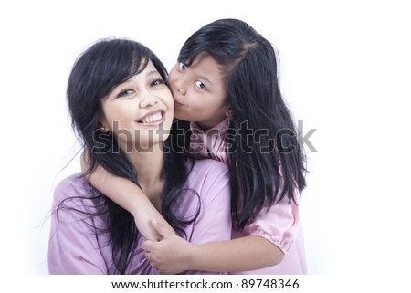 Happy mother and daughter isolated on white - stock photo