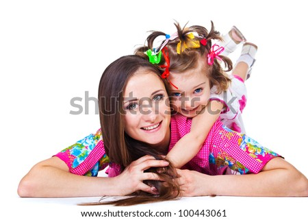 Happy mother and daughter, lying - stock photo