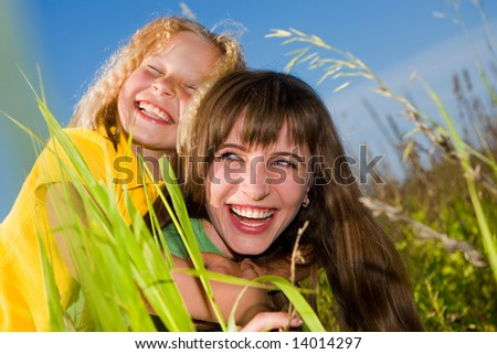 Happy mother and daughter on garden - stock photo