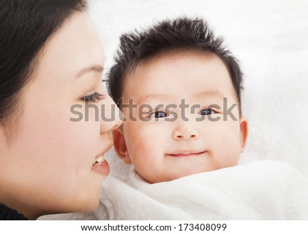 happy Mother and daughter or son smiling together - stock photo