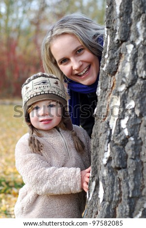 happy mother and daughter outdoors - stock photo