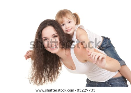 Happy mother and daughter playing on the white background - stock photo