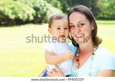 happy mother and daughter portrait outdoors - stock photo